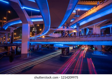 Night view of Shanghai city and highways with flowing traffic