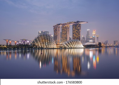 Night view of Singapore skyline, including:Gardens by the Bay, Supertree Grove, Cloud Forest, Flower Dome, Marina Bay Sands and the  Art Science Museum.
