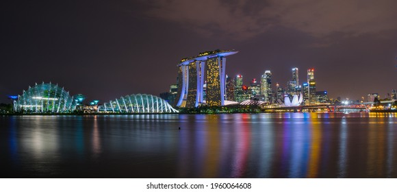 Night view of Singapore's famous attractions, Gardens by the Bay, Marina Bay Sands and ArtScience Museum. November 09, 2017