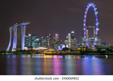 Night view of Singapore's famous attractions, Marina Bay Sands, ArtScience Museum and Singapore Flyer. November 09, 2017