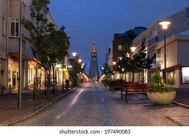 Night view of Skolavordustigur street leading to the Hallgrimskirkja Church, one of the landmarks of Reykjavik, the capital city of Iceland.