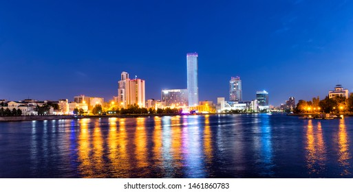 Night view of the skyscrapers of the city of Yekaterinburg. Russia. Reflection in the river