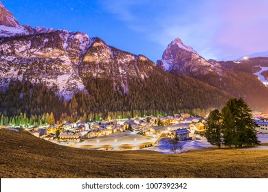 Night view of small town Penia near Canazei of Val di Fassa, Dolomites, Italy.