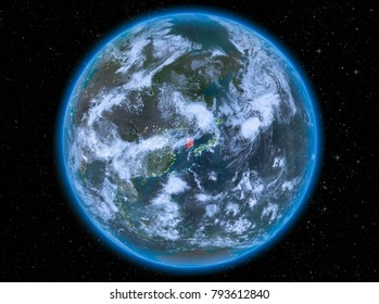 Night view of South Korea highlighted in red on planet Earth with atmosphere and clouds. 3D illustration. Elements of this image furnished by NASA.
