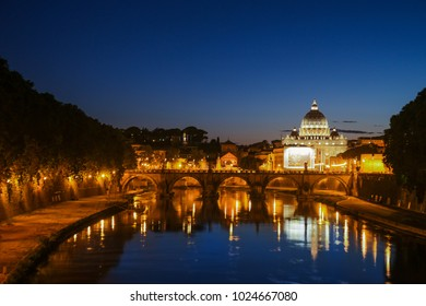 Night view of St. Peter's Basilica. Ponte Sant Angelo and Tiber River in Rome - Italy. Dramatic sunset with sbeautiful water reflection. Italy postcard