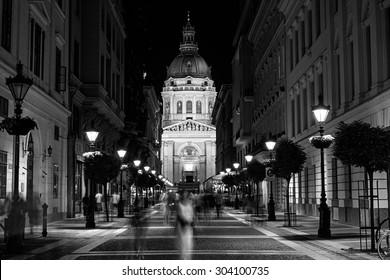 Night view of St. Stephen's Basilica through the busy streets of Budapest. Long exposure.
