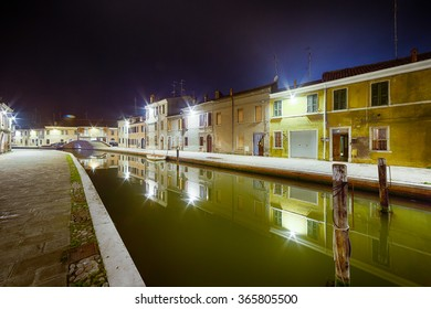 night view of the streets and canals of Comacchio, the little Venice of Emilia Romagna, illuminated by lights and decorations during Christmas