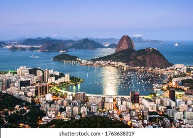 Night View of Sugarloaf Mountain and Botafogo in Rio de Janeiro With Moonlight Reflecting on Water