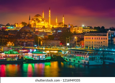 Night view to Suleymaniye Cami, from Galata Bridge, Istanbul, Turkey. Beautiful night view with colorful ships and reflection in the water of the Golden horn