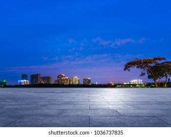 night view of suzhou skyline with tile floor on foreground,jiangsu province,China,Asia.