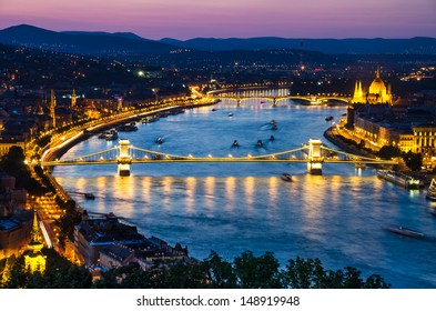Night view with Szechenyi Chain Bridge on river Danube, Budapest, with Orszaghaz Hungary Parliament building.