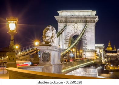 Night view of the Szechenyi Chain Bridge over Danube River and stone lion. Nightlife of Budapest, Hungary.