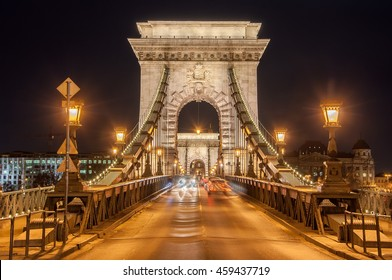 Night view of the Szechenyi Chain Bridge is a suspension bridge that spans the River Danube between Buda and Pest, the western and eastern sides of Budapest, the capital of Hungary.
