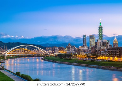 night view of taipei city by the river with taipei 101 tower