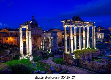 Night view of Temple of Saturn and Forum Romanum in Rome, Italy. Architecture and landmark of Rome. Antique Rome.