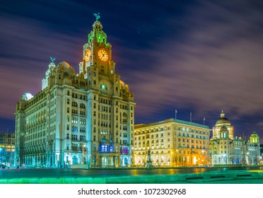 Night view of the Three Graces buildings in Liverpool, England