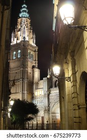 Night view of Toledo Cathedral viewed from a typical narrow street of the city of Toledo, Spain, a World Heritage Site,