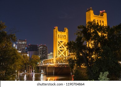 Night view of the Tower Bridge connecting Sacramento to West Sacramento; downtown area skyline visible in the background; California