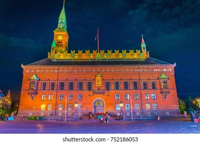 Night view of the town hall in Copenhagen during sunset.
