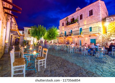 Night view of the traditional village of Areopoli in Mani region with the picturesque alleys and the stone built tower houses,  Peloponnese, Greece on August 18, 2018.
