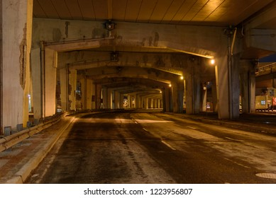 Night view of a tunnel with a road lit by street lamp