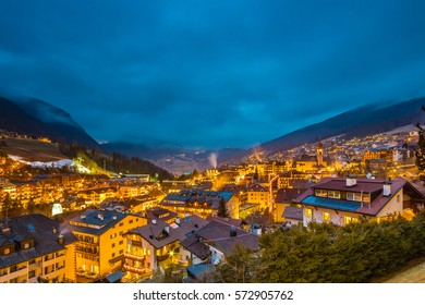 night view of typical mountain village in alpine valley in Italy