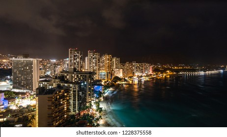 Night view of Waikiki Beach including the hotels and buildings in Waikiki, Honolulu, Oahu island, Hawaii. Waikiki Beach in the center of Honolulu has the largest number of visitors in Hawaii.