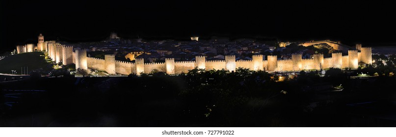 Night view of walls of Medieval city of Avila, Castile and león, Spain. City was declared a UNESCO World Heritage Site in 1985.
