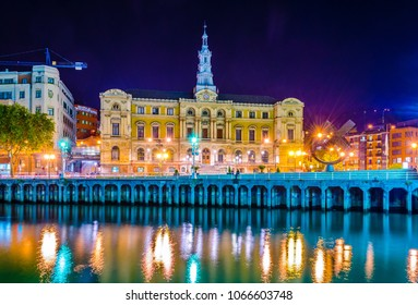 Night view of waterfront of Nervion river near the town hall in Bilbao, Spain