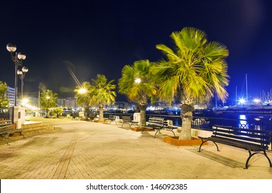 night view of the waterfront in Sliema. Malta. bench and lantern