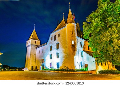 Night view of White Chateau de Nyon in Switzerland