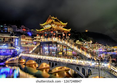 Night view of Xueqiao (Snow Bridge), one of the four most beautiful landscape bridge was contributed and constructed by Huang Yongyu, the famous Fenghuang-born painter in 2011.
