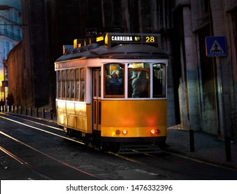 Night view of yellow tram in Lisbon, Portugal