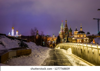 Night view in Zaryadye Park: Moscow Kremlin, St. Basil`s Cathedral and Varvarinskaya Church.