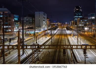 Night view of Zurich Altstetten train station in front of Zurich city