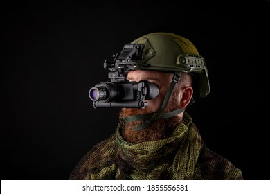 Night vision device attached to the helmet. A special device for observing in the dark. Equipment for the military, police and special forces.