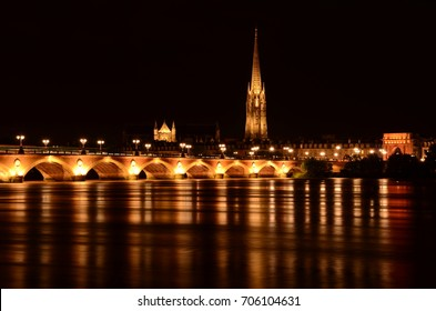 Night vision of Stone bridge and Saint Michel Basilica in the city of Bordeaux