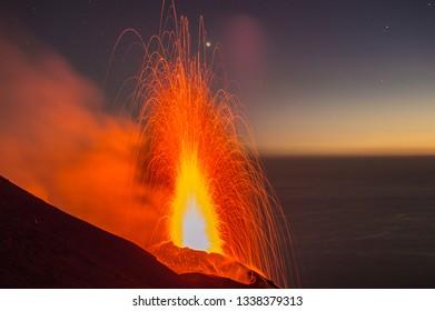 Night volcanic eruptions on the volcanic island of Stromboli, Aeolian archipelago, Sicily, Italy.