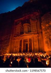 Night walk through the historical site Petra, Jordan.