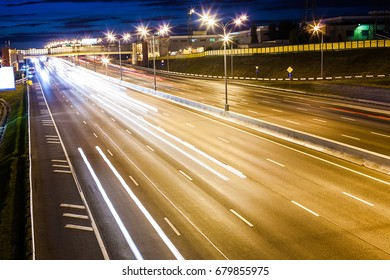 night wide highway with moving cars