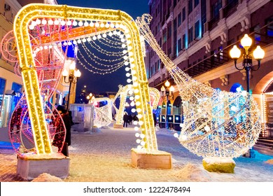 Night winter Moscow in the snow. Street Old Arbat decorated for the New year.
