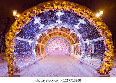 Night winter Moscow in the snow. Tverskaya street decorated for the New year. Light tunnel.