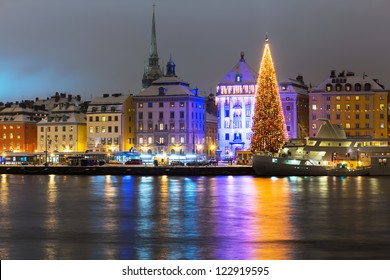 Night winter scenery of the Old Town (Gamla Stan) with Christmas Tree in Stockholm, Sweden