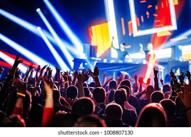 nightclub dj rave party with crowd of people hands up