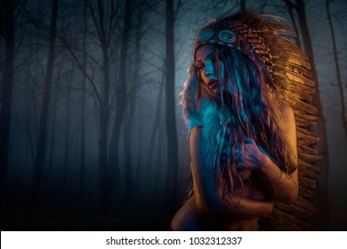Nightfall beautiful blonde with golden hair and sensual face with big american indian plume of brown feathers