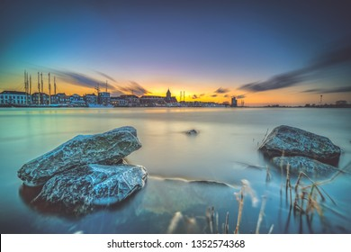 Nightfall with blue sky and long exposure above the old medieval city of Kampen in the Netherlands with its beautiful skyline