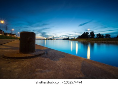 Nightfall with blue sky and long exposure above a city harbor along a lake near the Dutch city of Harderwijk