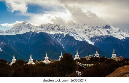 Nightfall of Meili(Meri) Snow Mountains. The photo is the some peaks in Meili Snow Mountains and some prayer banners Pagodas. Meili Snow Mountains is located in the northwest of Yunnan China.