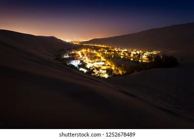 Nightfall in oasis town of Huacachina, Peru