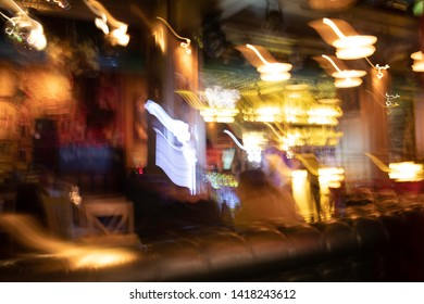 Nightlife abstract background with blurred lights of resturants and pubs.